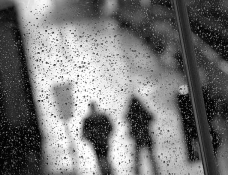 rain soaked window - City People