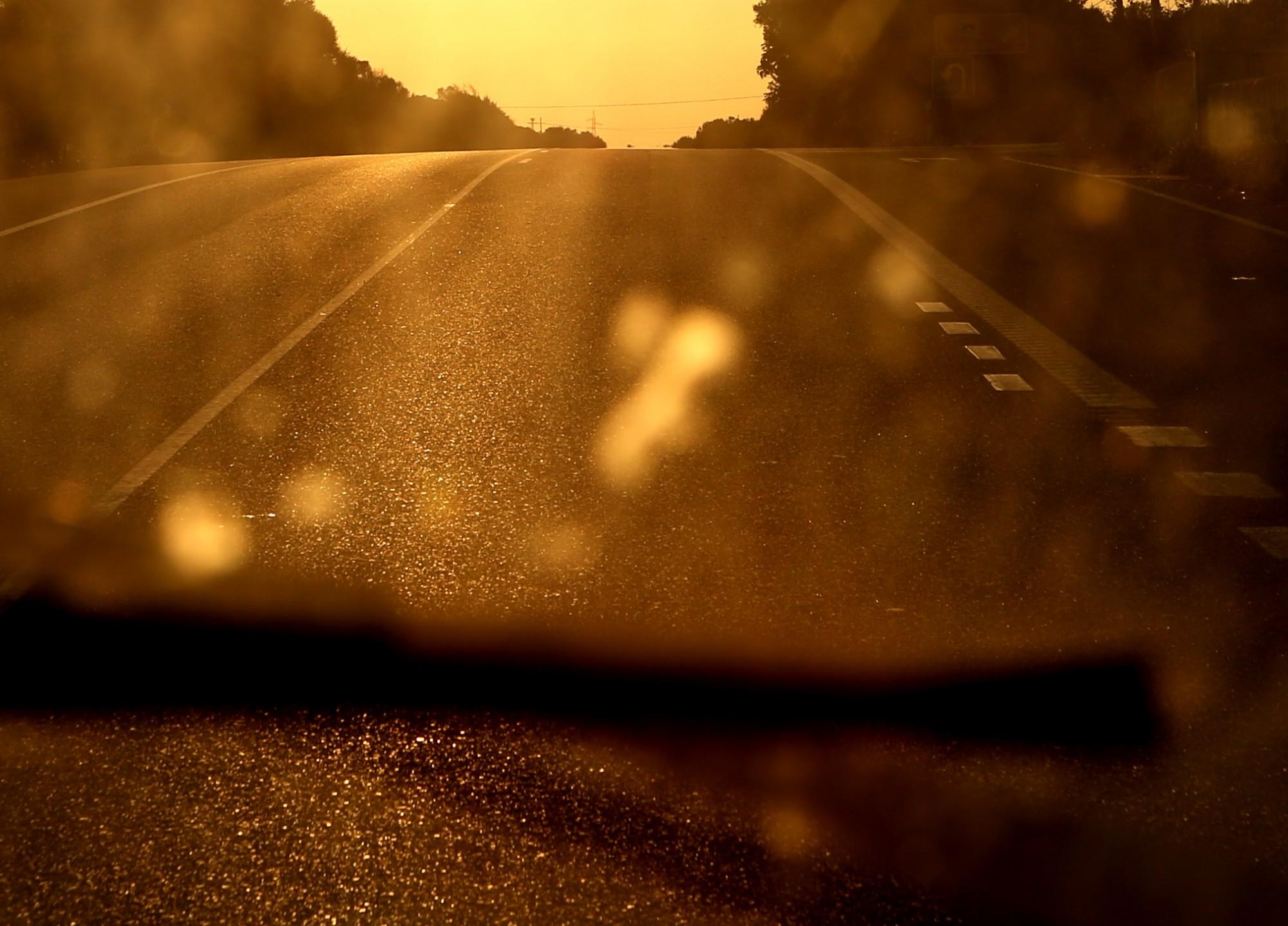 road through dirty window