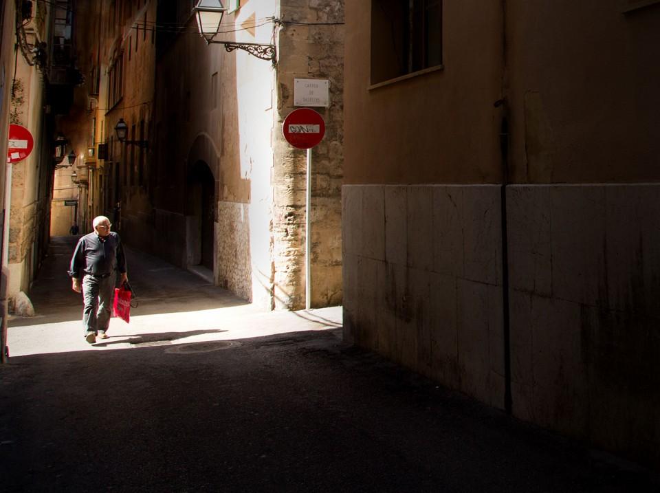 man in narrow street
