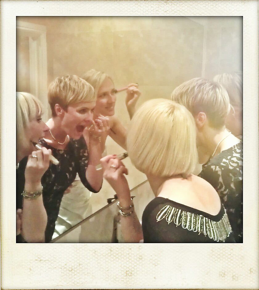 girls looking in mirror