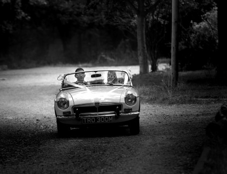 couple in classic car - The Wedding Car