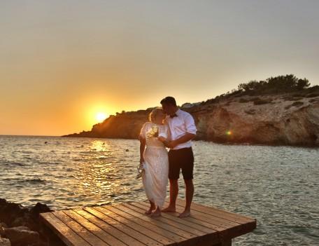 wedding couple kiss by sea - Elixir Shore Club