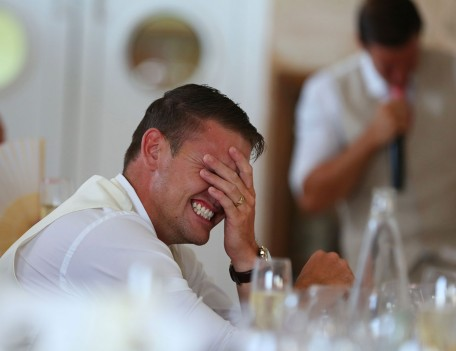 man holding his head in anguish - Favourite Wedding Faces