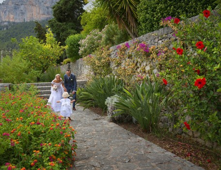bride, groom and daughter in garden - Son Berga