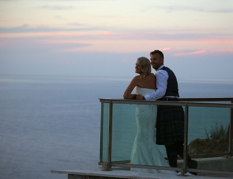 bride and groom on balcony - The Jumeirah Hotel