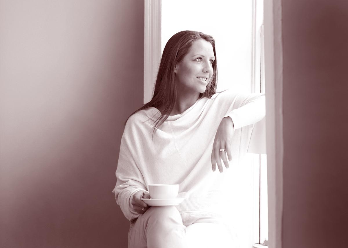 girl sat in window