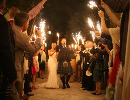 wedding couple with ceremonial flares - The Jumeirah Hotel