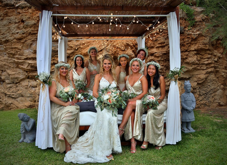 bride with bridesmaids on bed