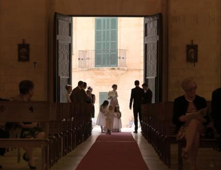 people enter church - Santa Maria Ciudadella