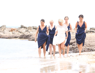 bride and bridesmaids on beach