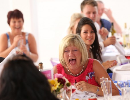 woman laughing at table - Favourite Wedding Faces