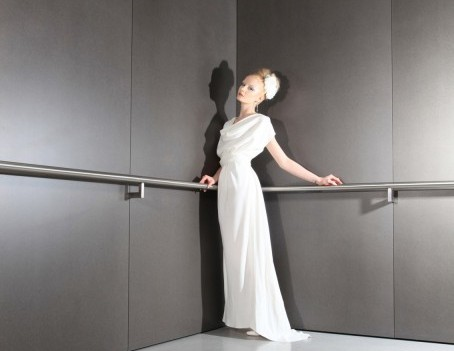 model against grey wall - Bridal Fashion