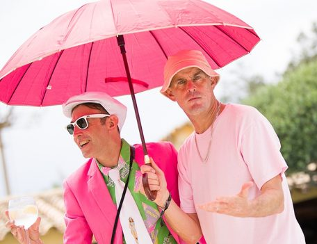 Men in pink with parasol - Pikes Hotel