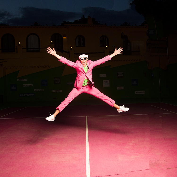 Man in pink suit
