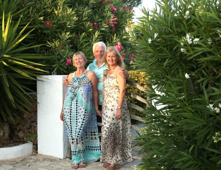 Three people by gate - Casa Merdeka Menorca