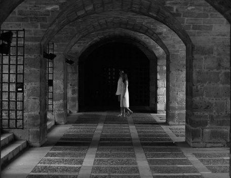 Couple under archways - Palma Engagement Shoot