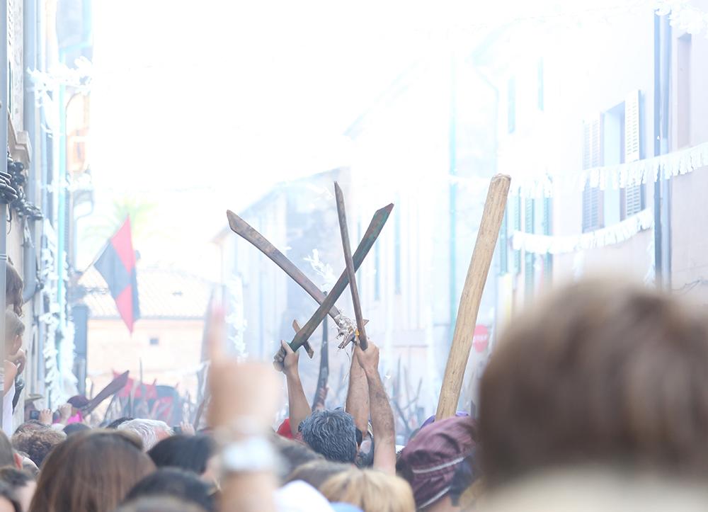 Wooden swords in crowd