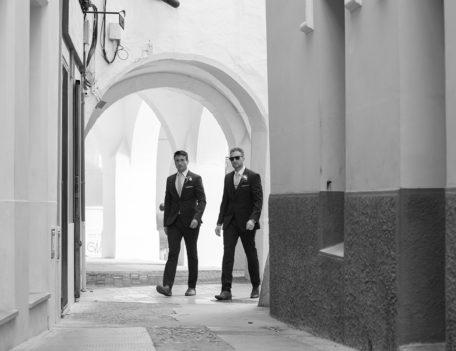 Two suited men walking in streert - Santa Maria Ciudadella