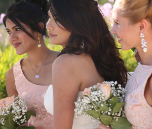 three girls in wedding dresses