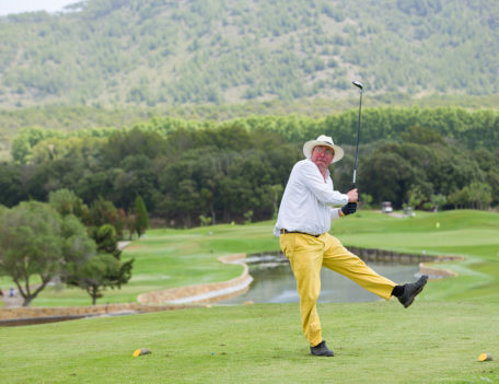 man on golf course - Hotel Can Simoneta