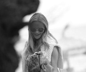 girl in sunglasses smiles