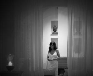 woman behind curtains