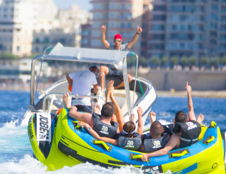 men on inflatable with speed boat - ITC Malta