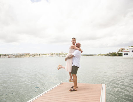 man holding woman aloft - Casa Venecia Anniversary
