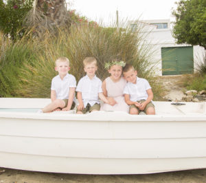 four kids sat in a small boat