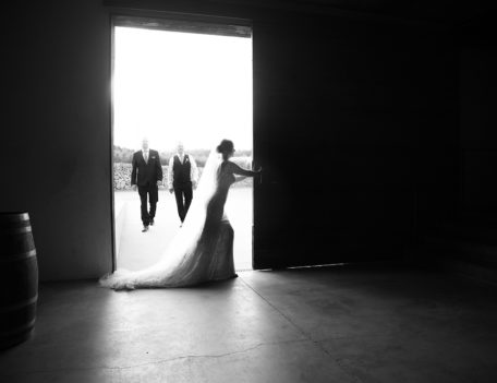 bride pushes sliding door back - Binifadet Basement