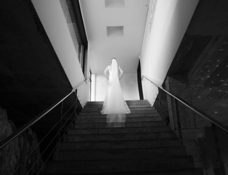 bride on steps - Binifadet Basement