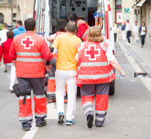 medics help injured man