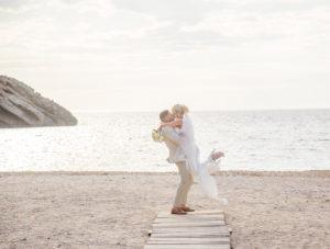 couple embrace on beach