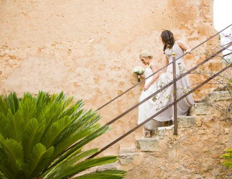 bride with bridesmaid walking down steps - Son Mir