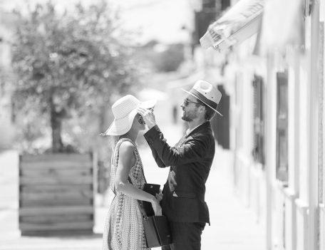 man puts hat on woman - Hotel Sant Joan de Binissaida
