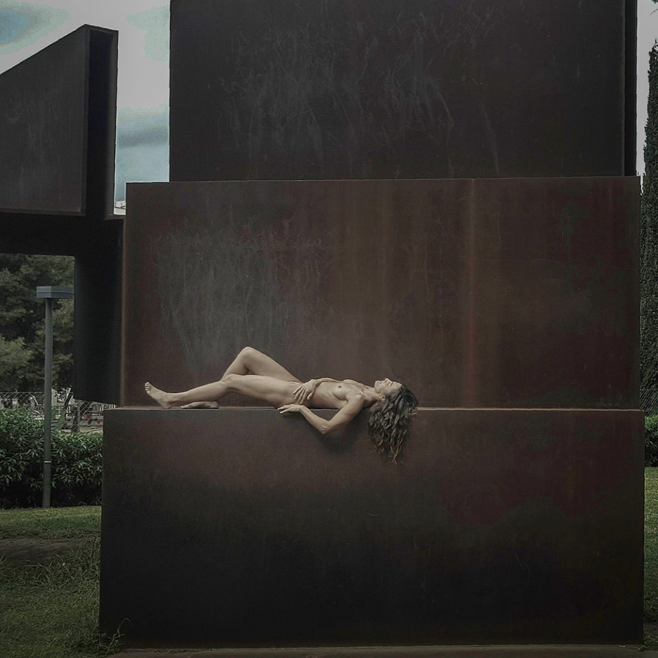 Naked woman on sculpture