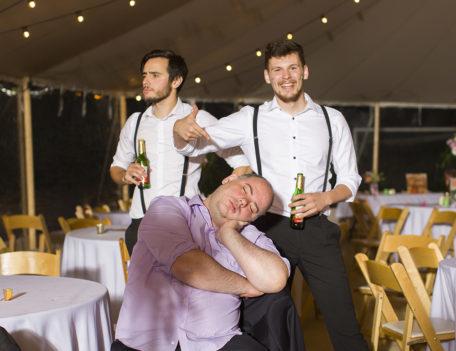 man asleep in chair - English Wedding