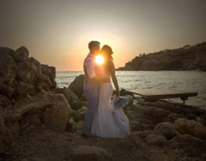 couple kiss with sunset