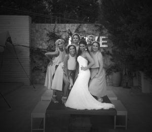 bride with bridesmaids on table