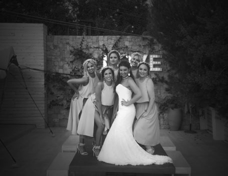 bride with bridesmaids on table - Elixir Shore Club