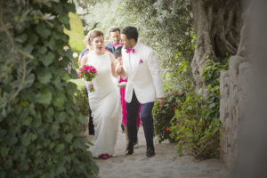 wedded couple walk up path