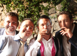 groom with friends pose for photograph