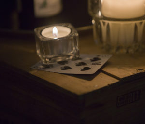 playing card with candle