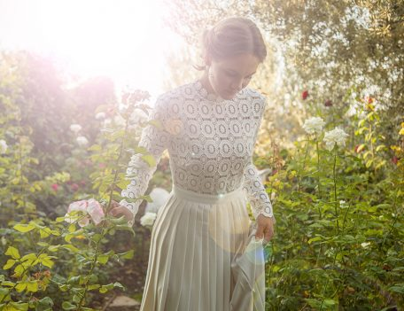 bride in rose garden - Wedding Portraits