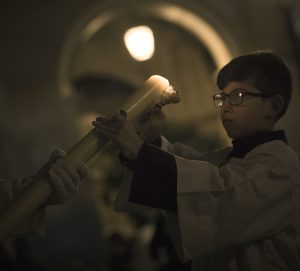 boy with alter candle
