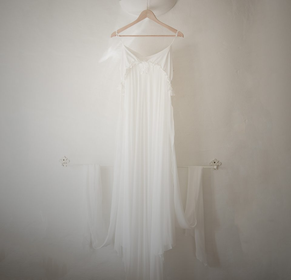 wedding dress hung on lamp shade