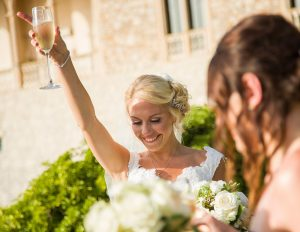bride celebrates with champagne glass
