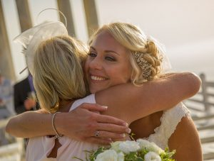 woman congratulates bride