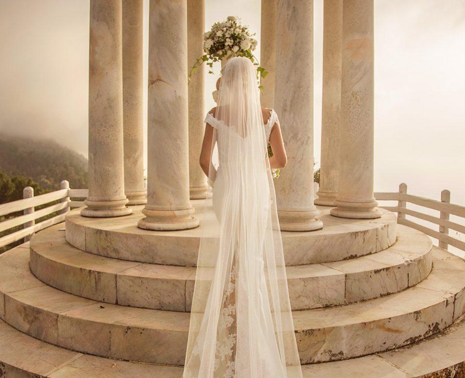 back of bride dress on steps