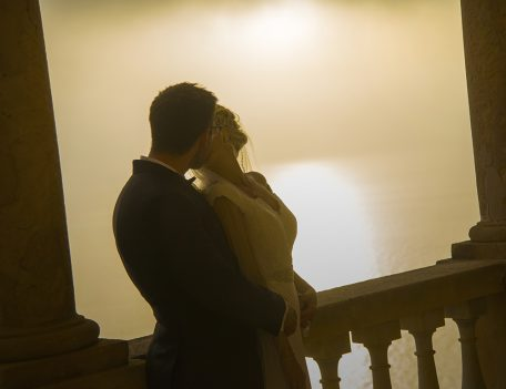couple kiss on balcony - The Bride at Son Marroig
